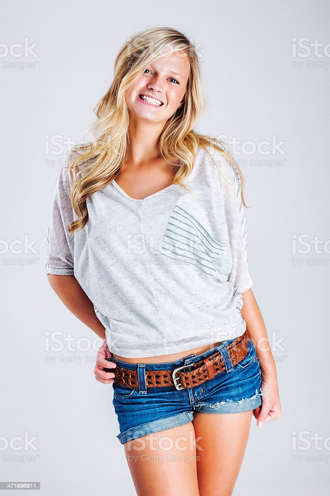 Attractive Casual Young Blonde Woman on Gray Backdrop stock photo