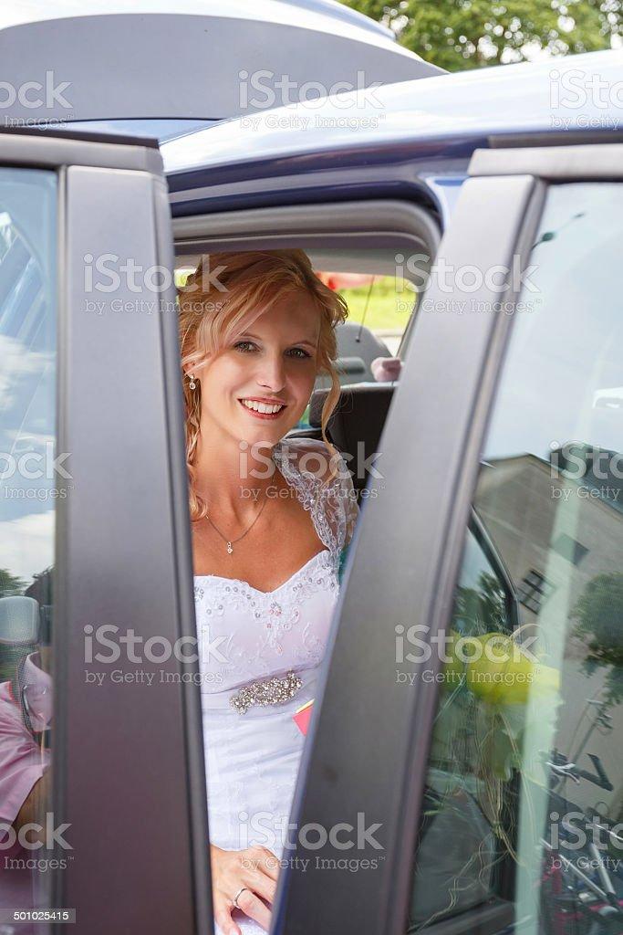 attractive caucasian bride sitting in car stock photo
