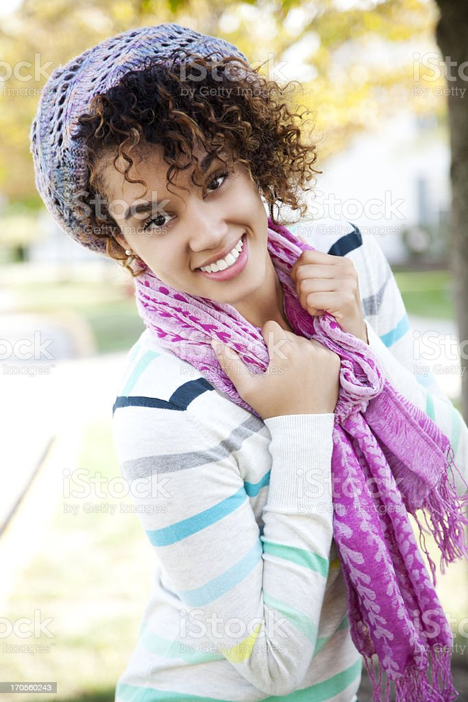 Attractive cheerful woman wearing a scarf royalty-free stock photo