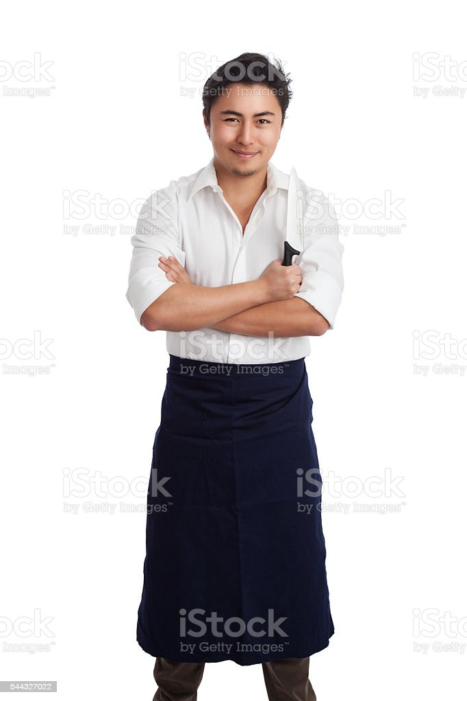 Attractive chef with knife stock photo