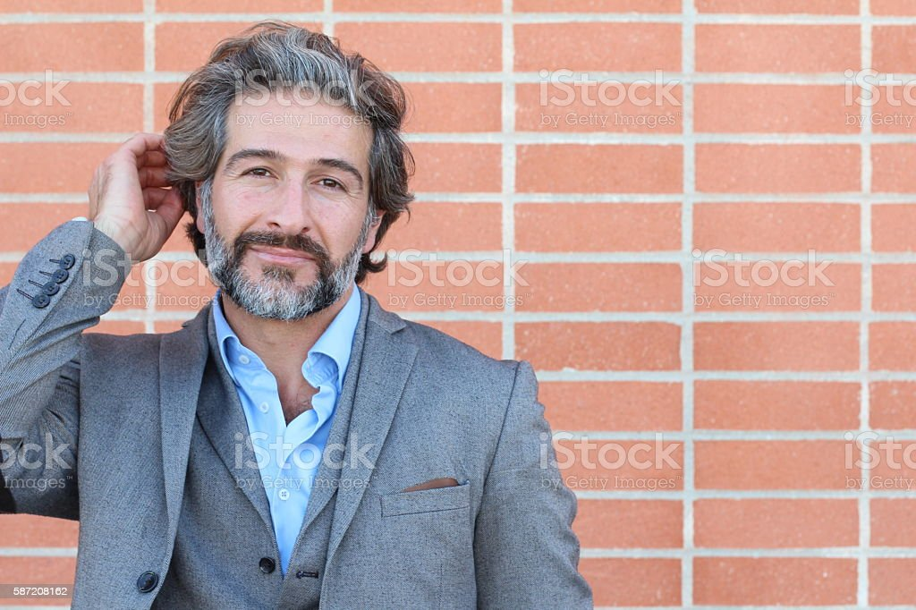 Attractive classy man touching his hair stock photo