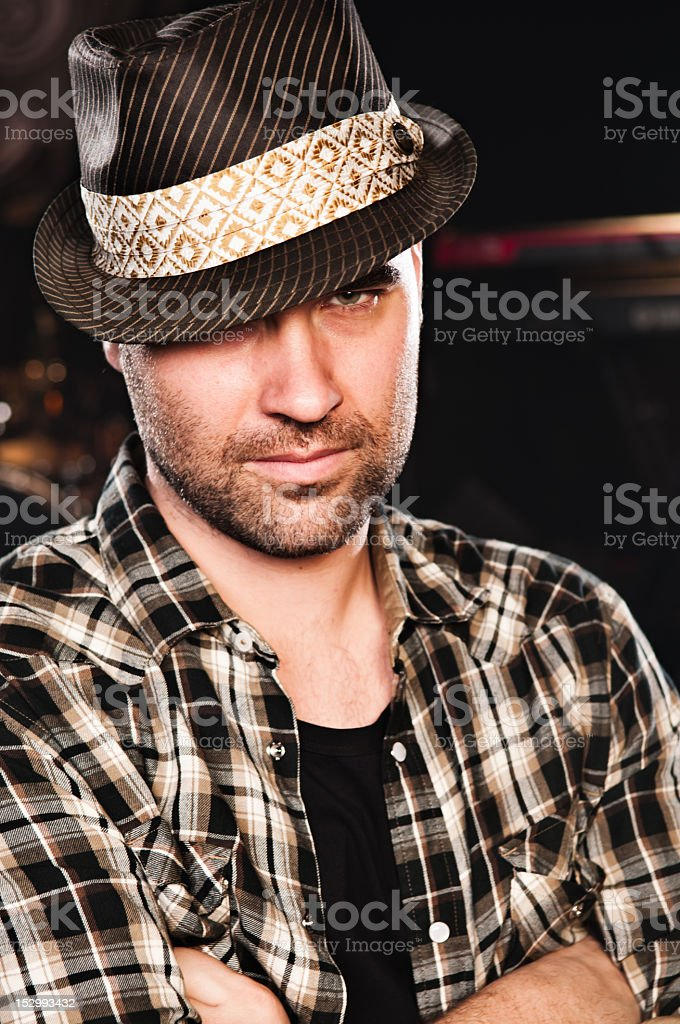 Attractive cool young adult with hat portrait stock photo