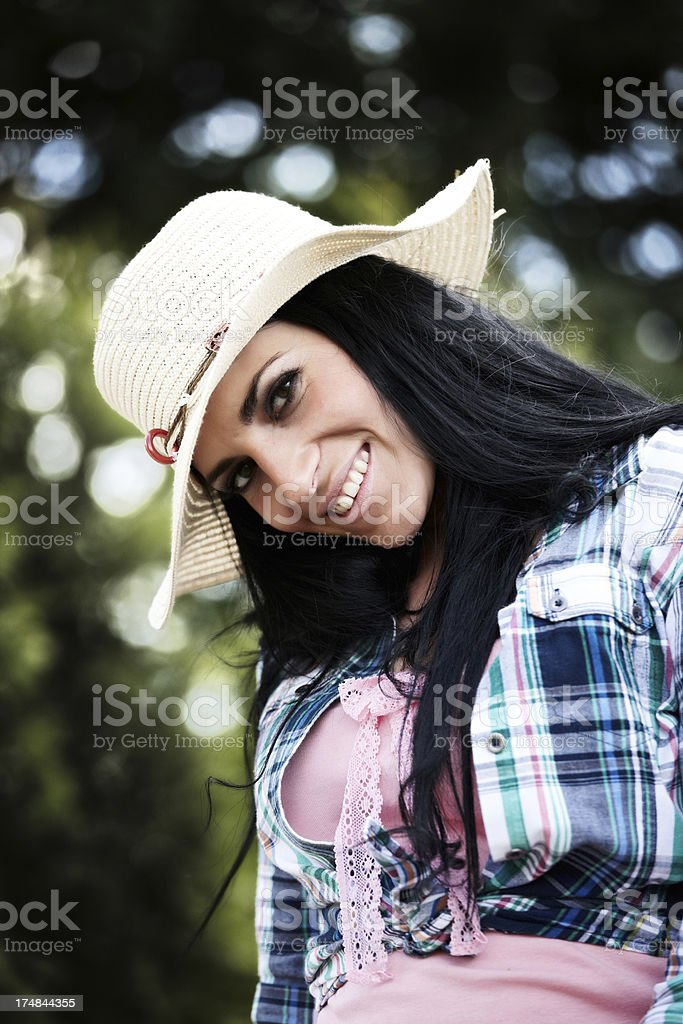 Attractive country girl in straw hat royalty-free stock photo
