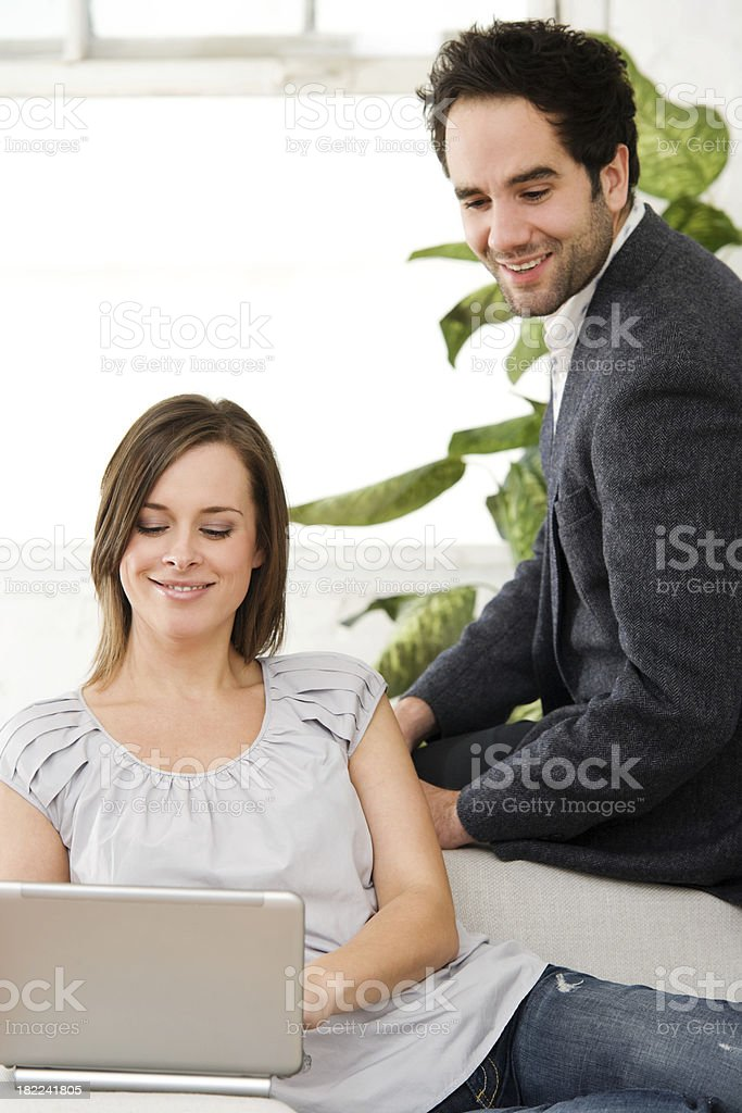 Attractive Couple at Home Using Netbook Computer royalty-free stock photo