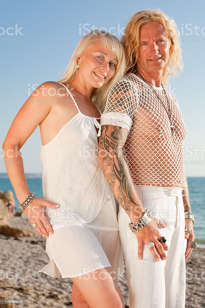 Attractive couple at the sea royalty-free stock photo