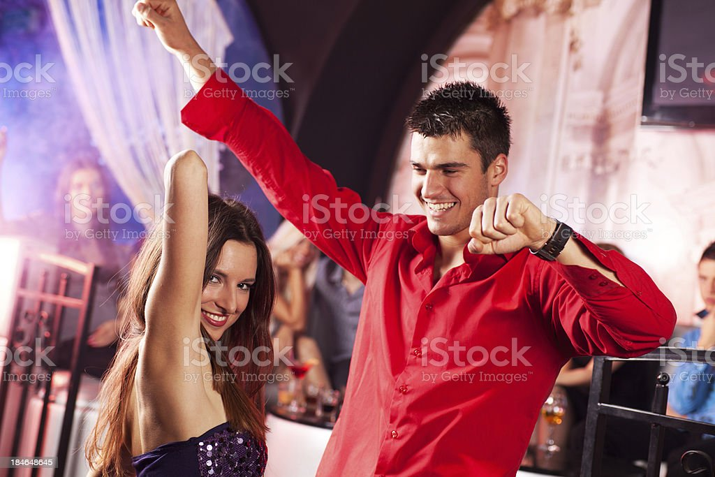 Attractive couple dancing at the disco club royalty-free stock photo