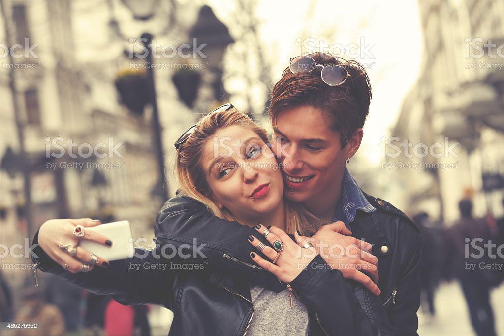 Attractive couple doing selfie outdoors stock photo