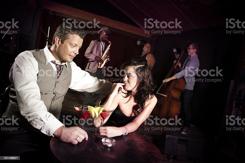 Attractive Couple Enjoying Drinks at Nightclub Bar royalty-free stock photo