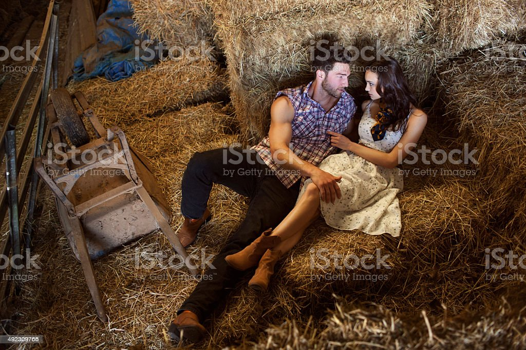 Attractive Couple Getting Intimate in a Barn stock photo