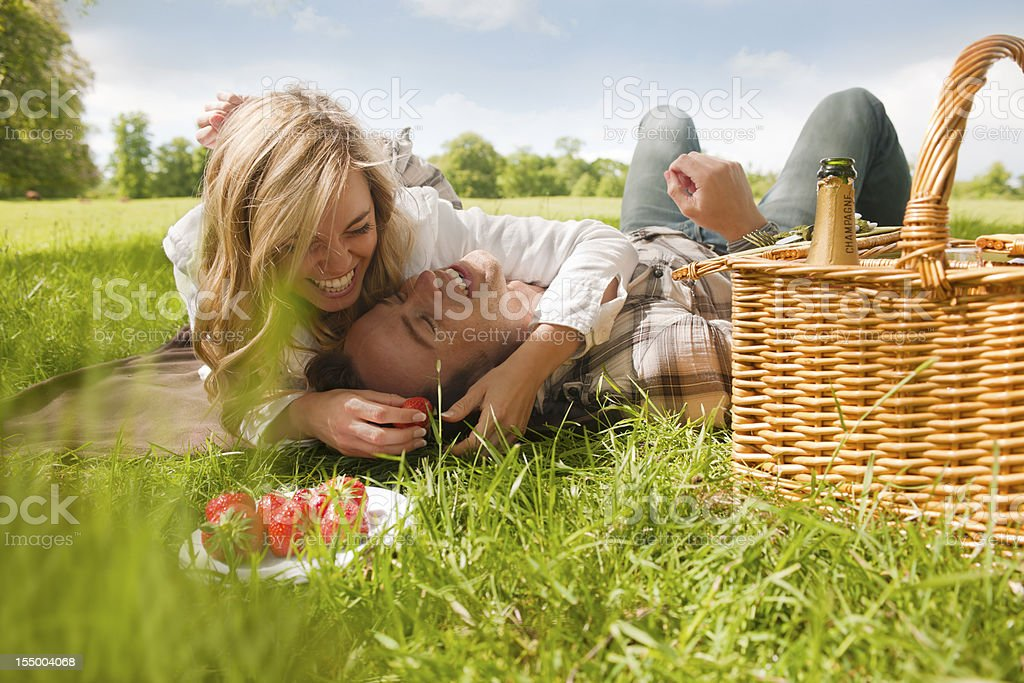 attractive couple having picnic royalty-free stock photo