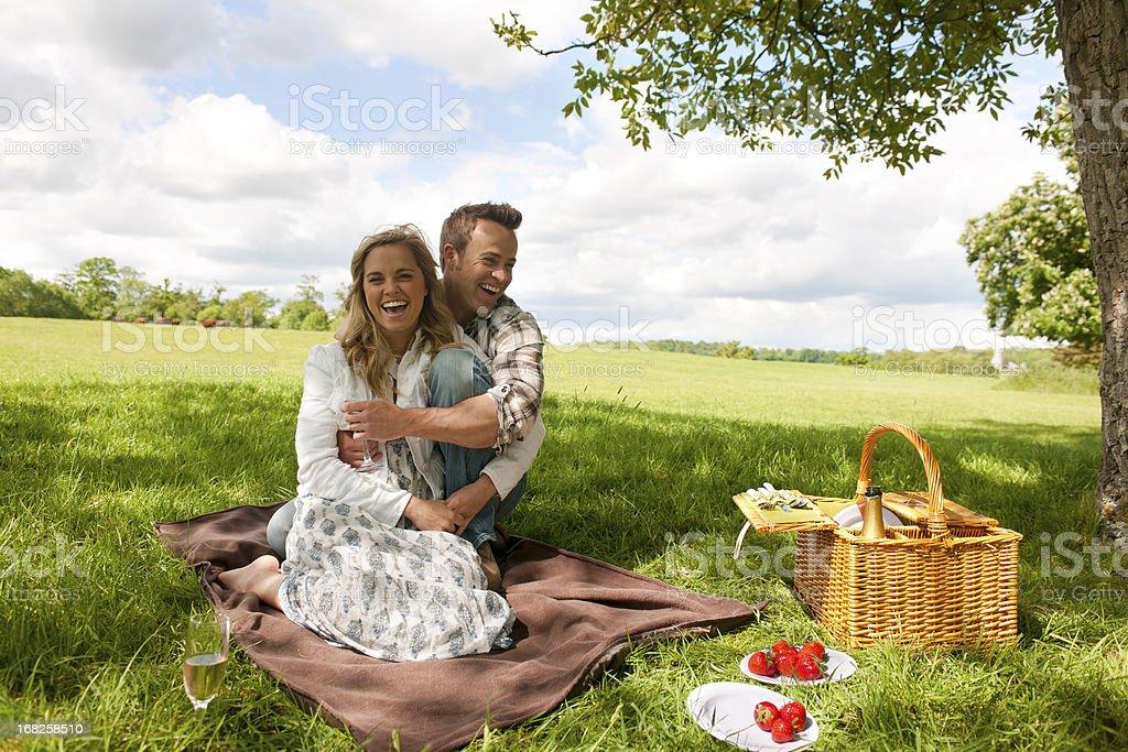 attractive couple having picnic royalty-free stock photo