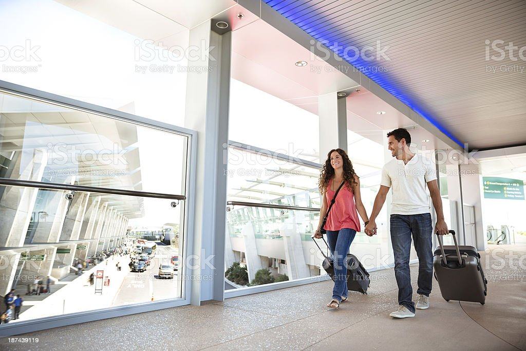 Attractive couple in an airport royalty-free stock photo