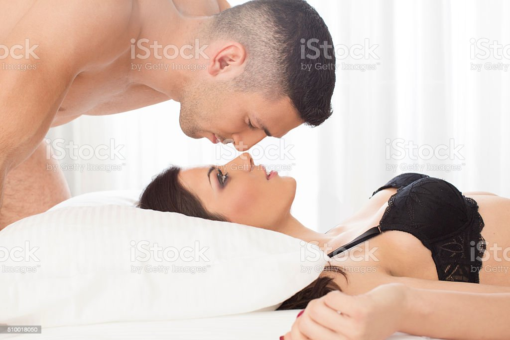 Attractive couple in bed stock photo
