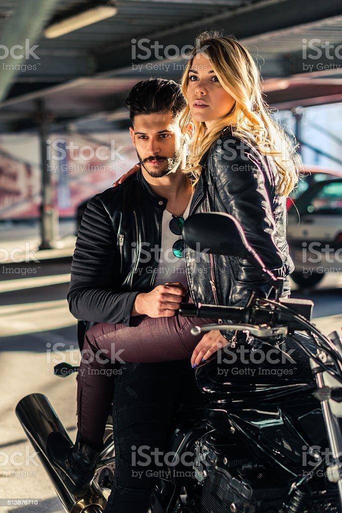Attractive couple of bikers stock photo