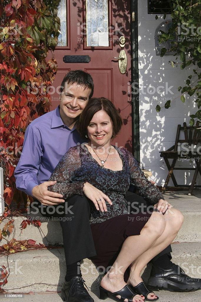 Attractive Couple on Doorstep royalty-free stock photo