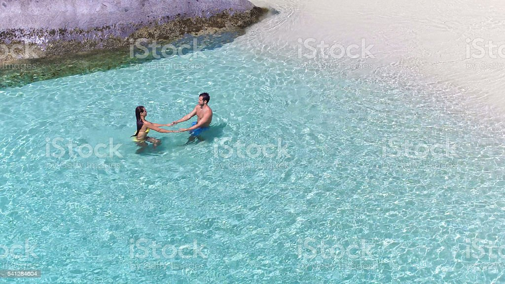 attractive couple relaxing at a tropical beach stock photo