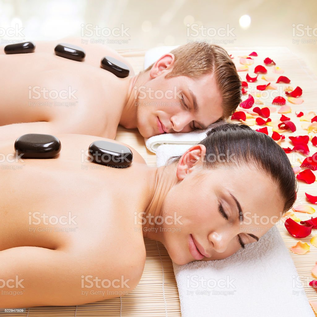 Attractive couple relaxing in spa salon. stock photo