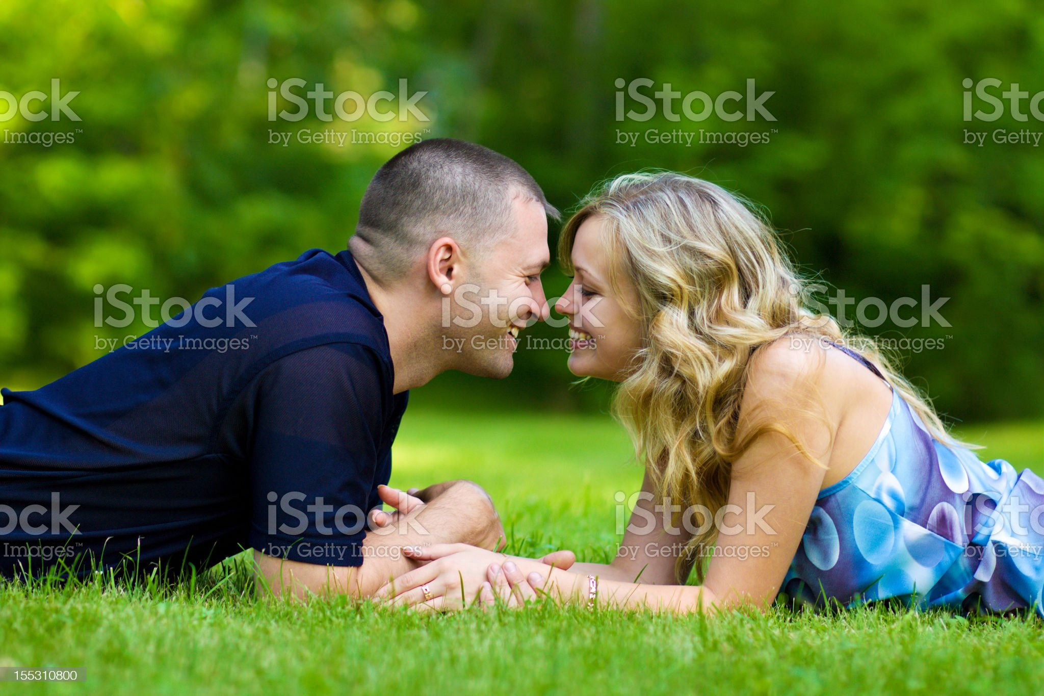 Attractive couple together on meadow royalty-free stock photo