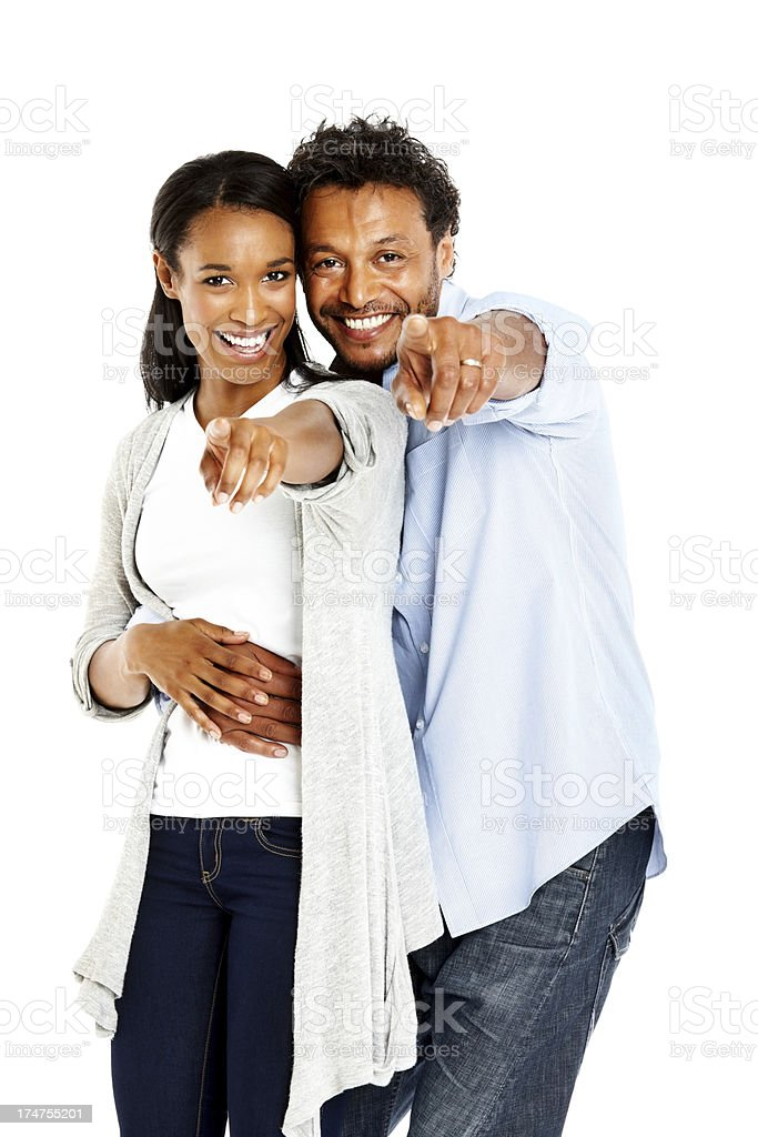 Attractive couple together pointing at camera royalty-free stock photo
