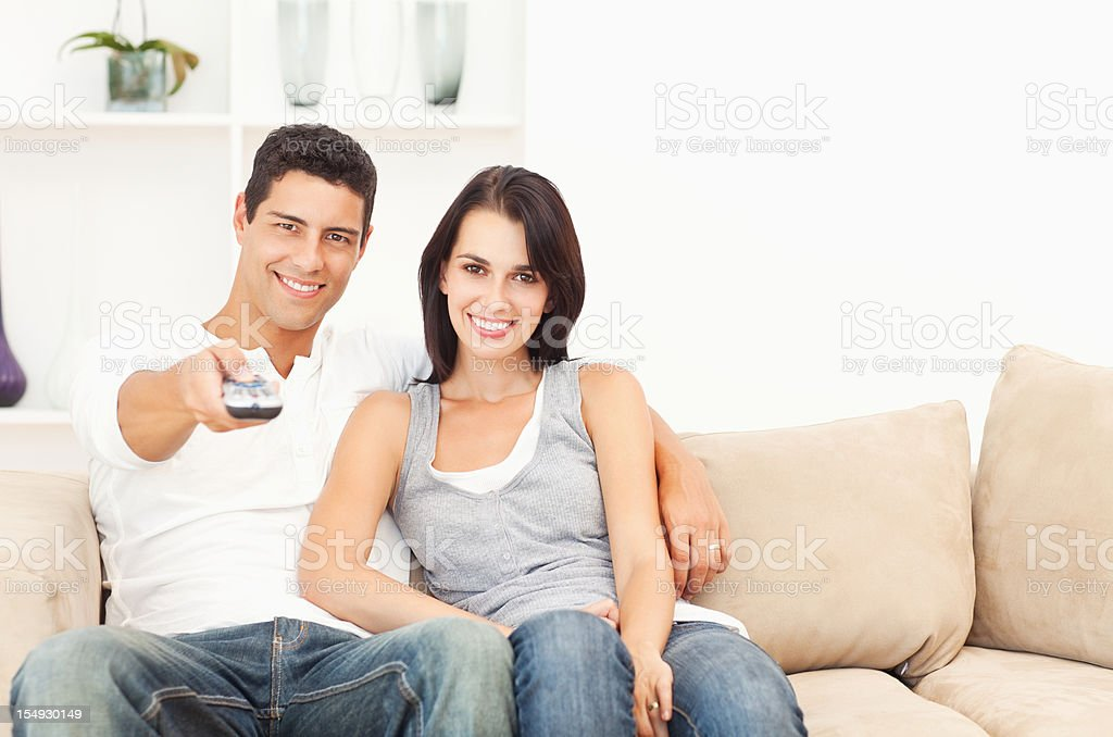 Attractive Couple Watching TV royalty-free stock photo