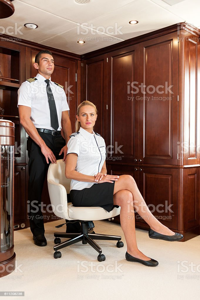 Attractive crew members is yacht stock photo