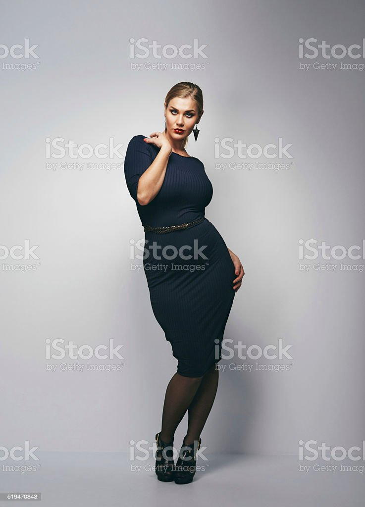 Attractive curvy woman in black dress stock photo