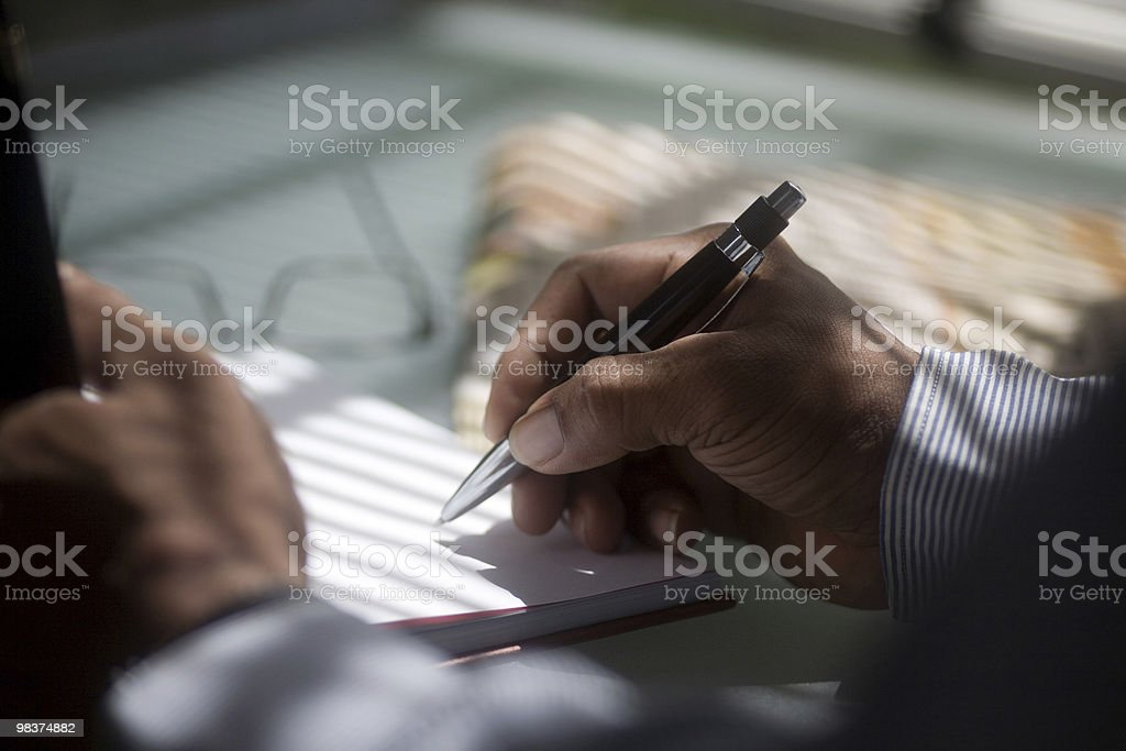Attractive desktop office scene with pen poised. royalty-free stock photo