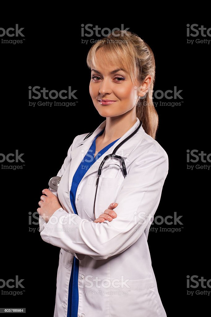Attractive doctor with stethoscope stock photo