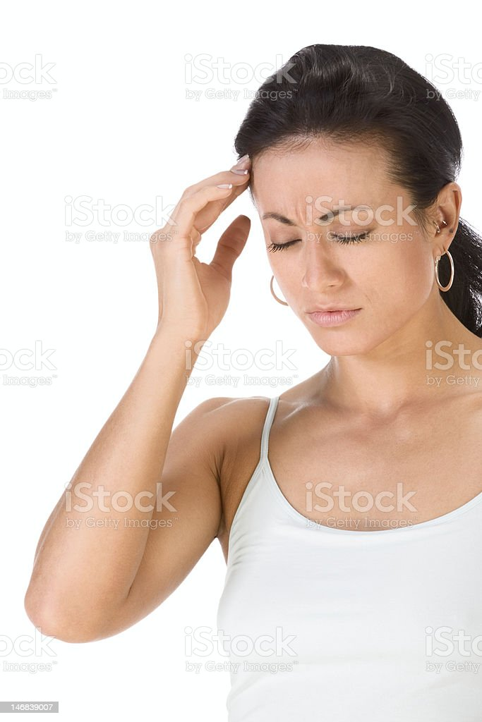 Attractive ethnic woman suffering from headache stock photo