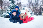 Attractive family having fun in a winter park