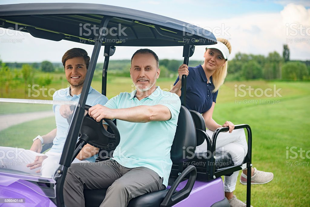 Attractive family in their golf cart stock photo