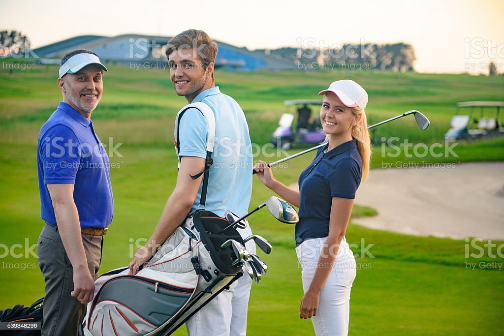 Attractive family on golf course stock photo