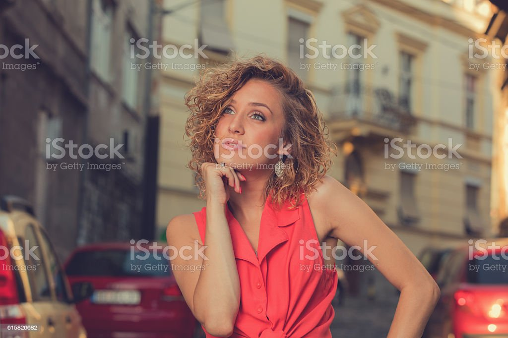Attractive fashionable woman posing on the street. stock photo