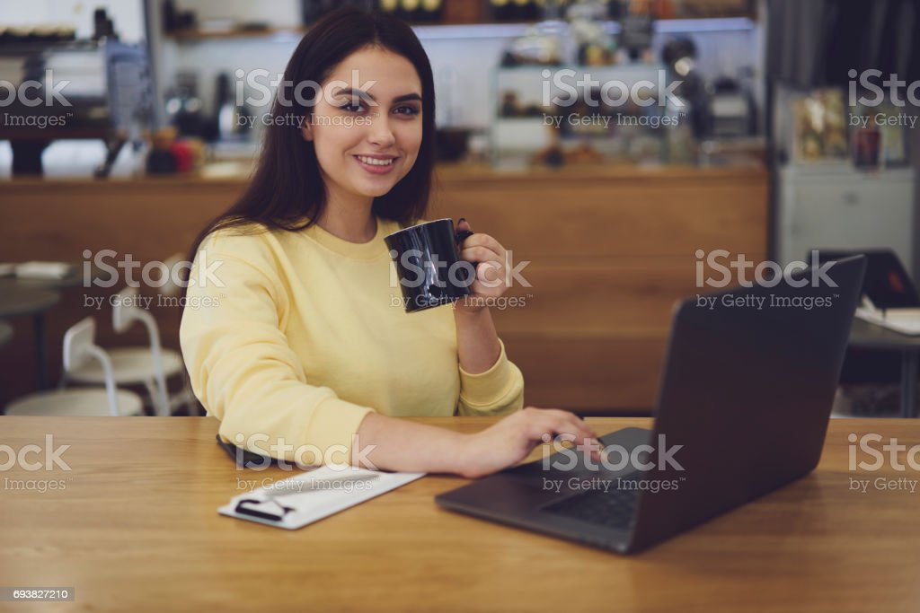 Attractive female administrative manager and free 4G connection in cafeteria stock photo