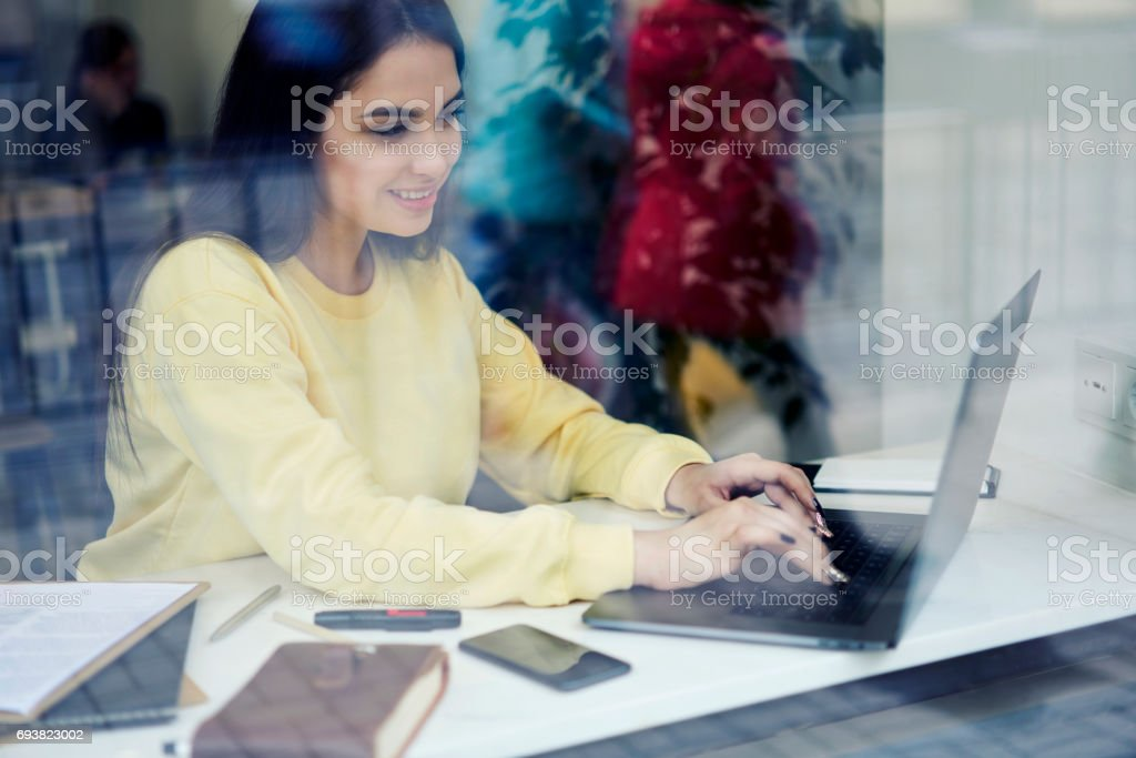 Attractive female administrative manager for searching ideas in internet stock photo