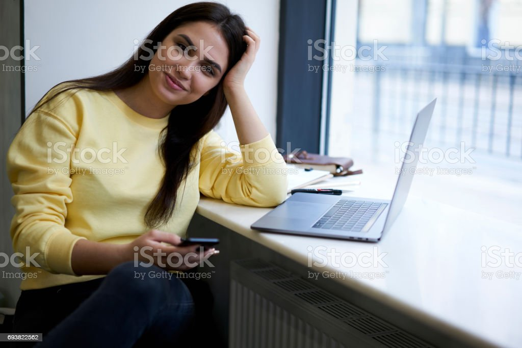 Attractive female administrative manager with digital devices and using 4G wifi stock photo