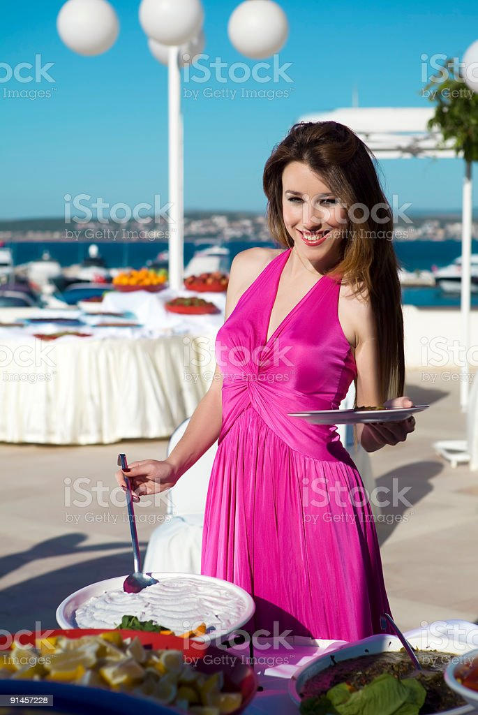 Attractive female at the buffet royalty-free stock photo