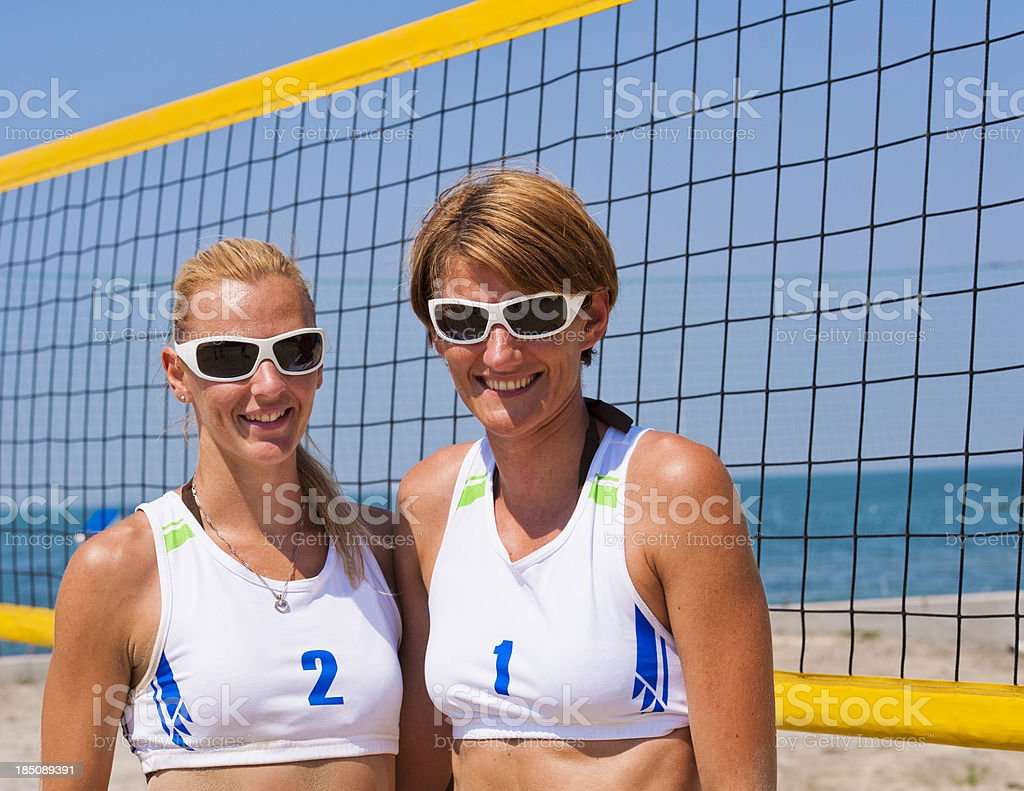 Attractive female beach volley players posing royalty-free stock photo