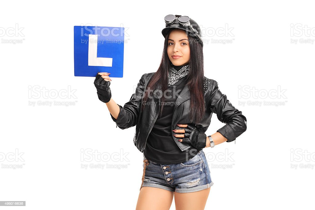 Attractive female biker holding an L-sign stock photo
