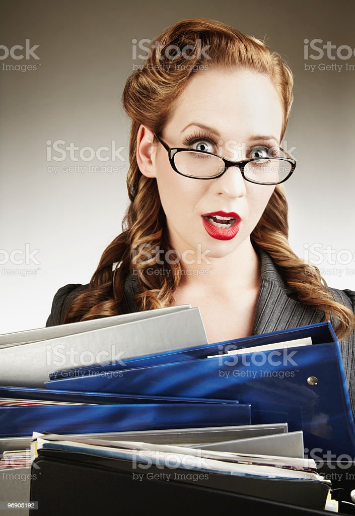 Attractive Female College Student Looking Overwhelmed, Holding Notebooks royalty-free stock photo