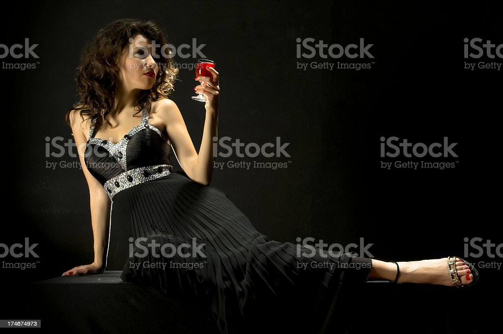 attractive female drinking wine royalty-free stock photo