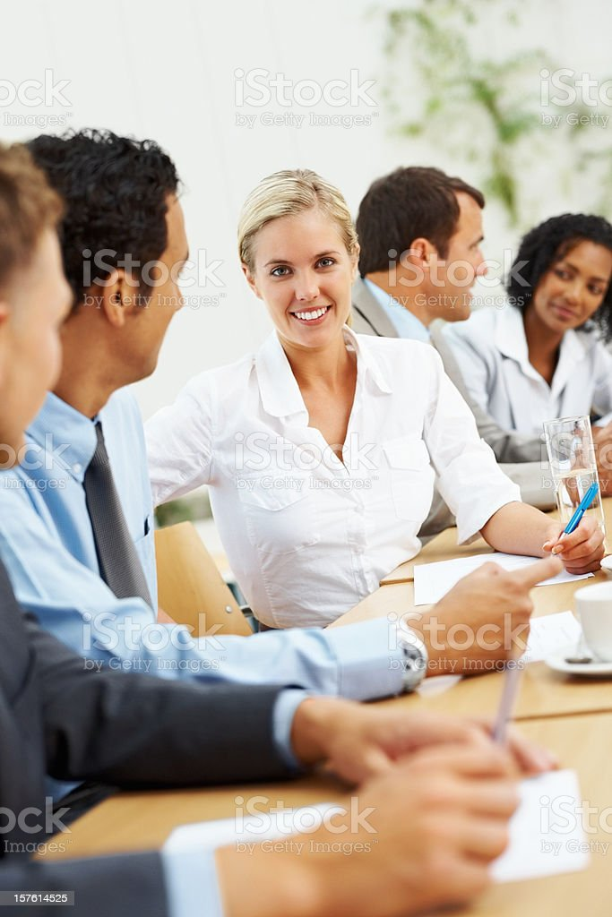 Attractive female executive with colleagues in a business meeting royalty-free stock photo
