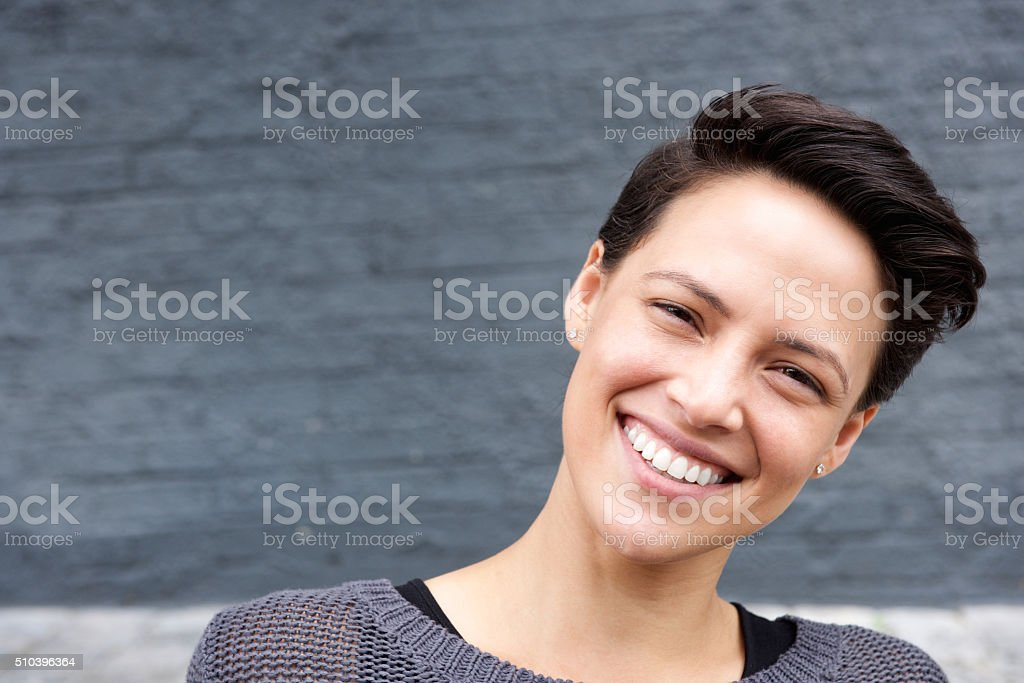 Attractive female face with short hair stock photo