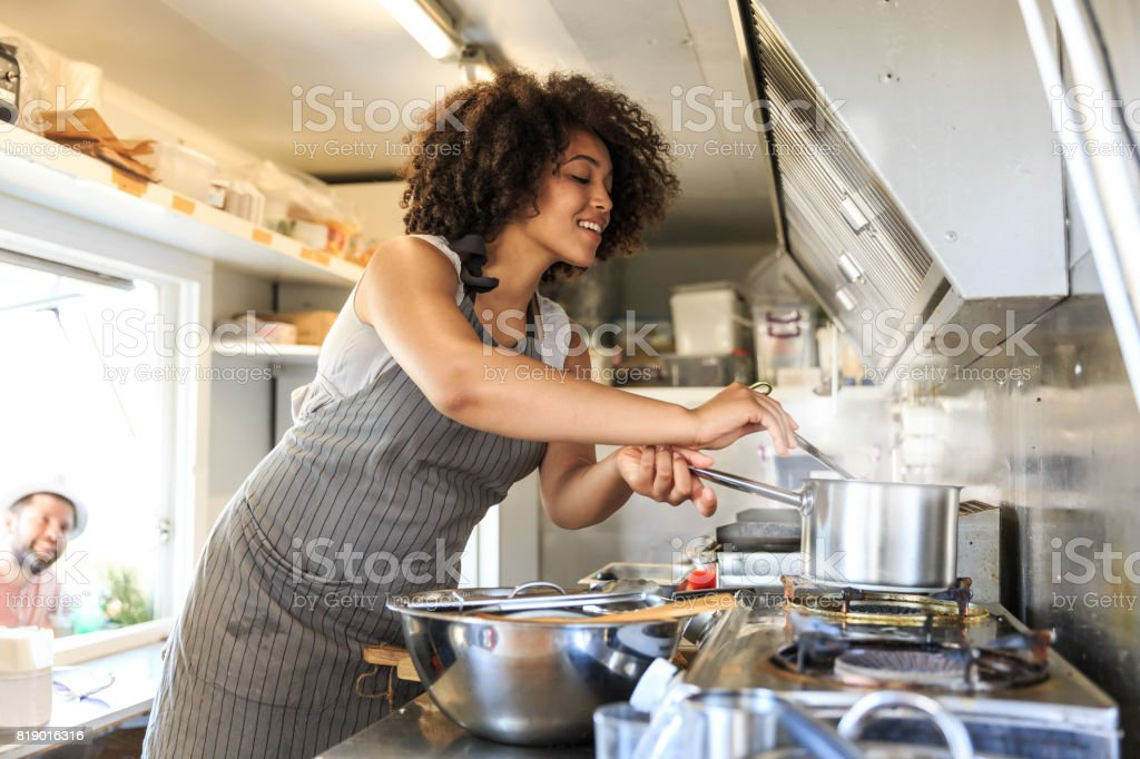 Attractive female fast food worker stock photo