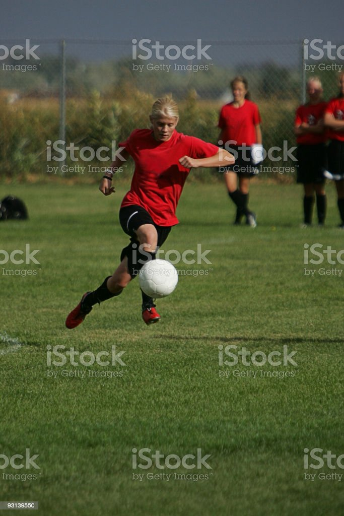 Attractive Female Foots Ball in air for Dynamic Dribble royalty-free stock photo
