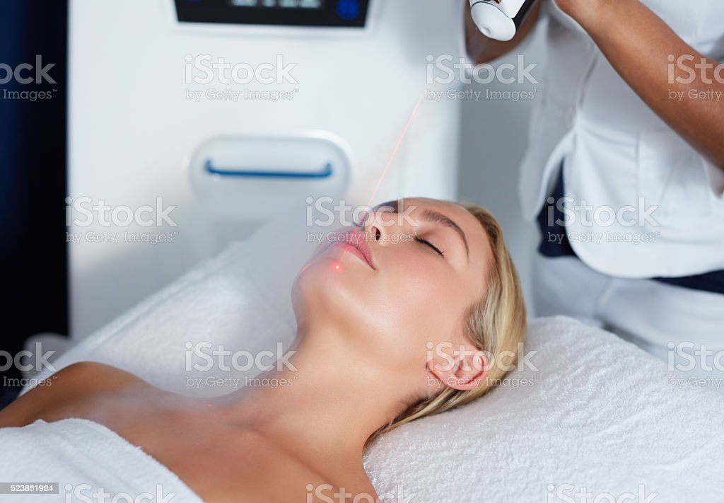 Attractive female getting local cryotherapy therapy stock photo