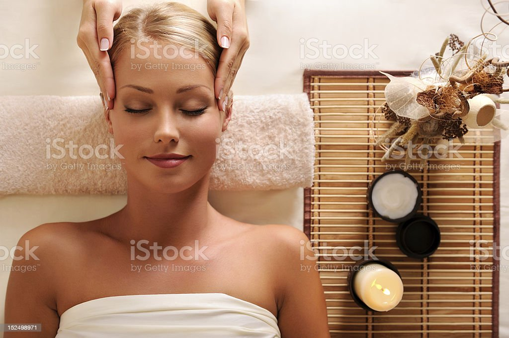 attractive female getting recreation massage of head stock photo