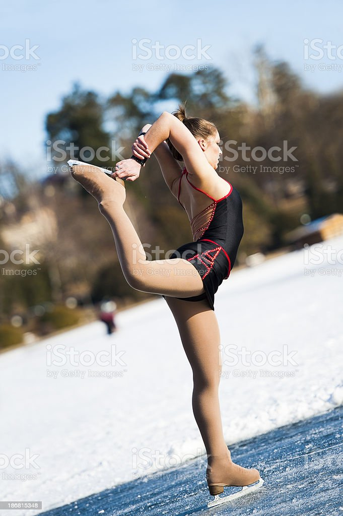 Attractive female ice skating on Bled lake stock photo
