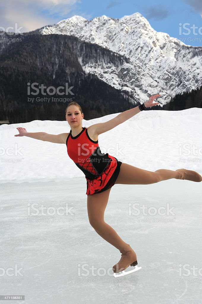 Attractive female ice skating stock photo
