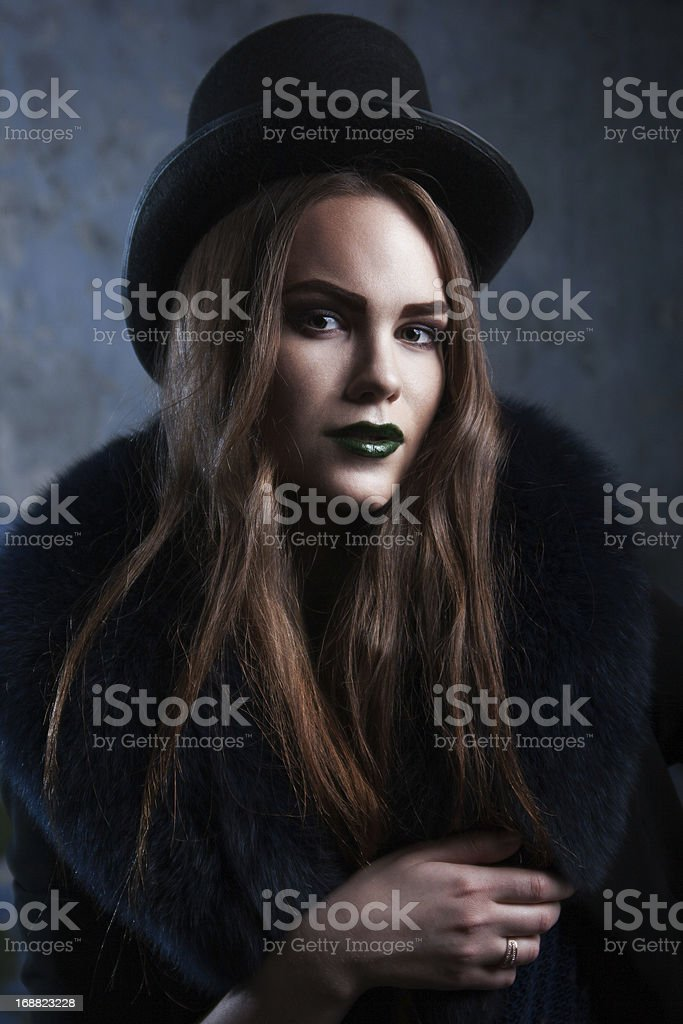 attractive female in cylinder hat royalty-free stock photo